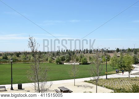 IRVINE, CA - MARCH 24, 2017: Joggers in the Jeffrey Open Space Trail. This open space corridor is one element in the citys overall open space system, linking the conservation and open space lands.