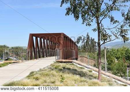 IRVINE, CA - MARCH 24, 2017: Jeffrey Open Space Trail bridge. An open space corridor part of the citys overall open space system with bridges and tunnels for pedestrians to bypass street crossings