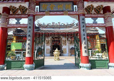 Hoi An, Vietnam, March 8, 2021: Colorful Entrance Door Of A Taoist Temple In Hoi An, Vietnam
