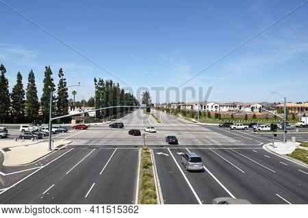 IRVINE, CA - MARCH 24, 2017: Irvine Boulevard and Jeffrey Road intersection. Viewed from the Jeffrey Open Space Trail foot bridge over the street, looking towards the Northwood Village.