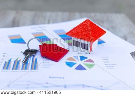 Orange Roof Houses And Keys Placed On Graphs Or Business Data. Business Growth Ideas, Economic Chart
