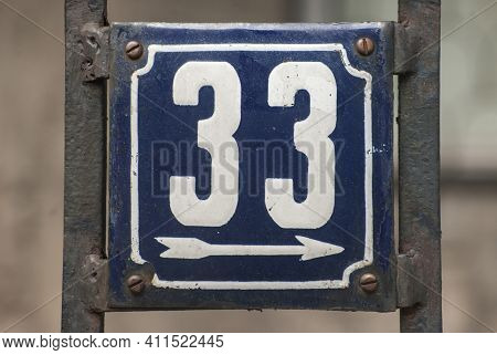 Weathered Grunge Square Metal Enamelled Plate Of Number Of Street Address With Number 33
