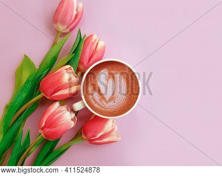 Cup Of Coffee. Tulip Flower On Colored Background