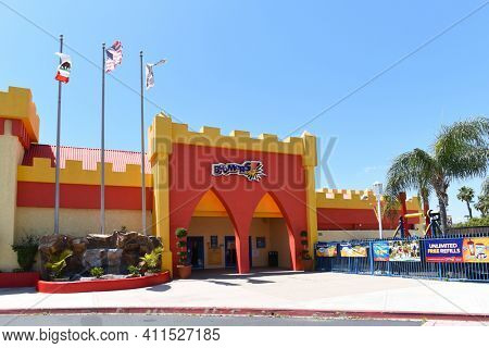IRIVNE, CALIFORNIA - 21 APRIL 2020: Boomers is a national amusement center chain featuring mini-golf, go-karts, bumper boats, rides, batting cages and arcade games.