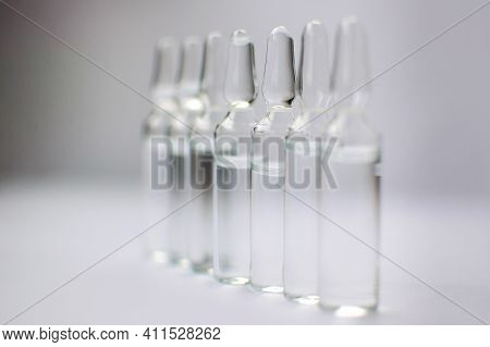 Medical Ampoules For Injection Isolated On White Background. Medicines And Disease Treatment, Pharma