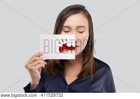 Asian Woman In The Dark Blue Shirt Holding A Paper With The Broken Tooth Cartoon Picture Of His Mout