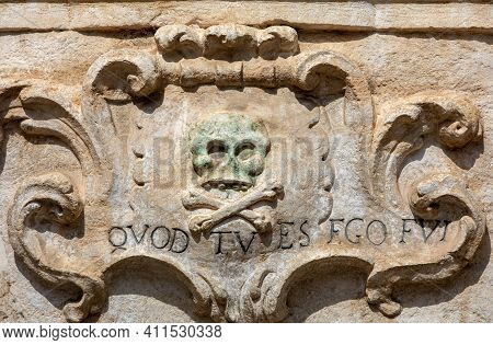 A Bas-relief With A Skull And A Latin Inscription From The Facade Of The Church Of Purgatorio In Gra