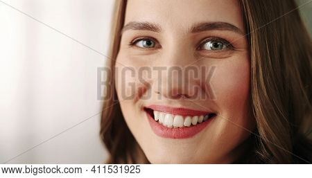 Close Up Shot Of Joyful Positive Caucasian Happy Young Beautiful Woman With Smile On Face Stands In