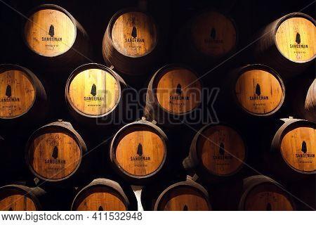 Porto, Portugal: Old Wooden Barrel Inside The Winery Sandeman, It Making Porto Wine From 18th Centur
