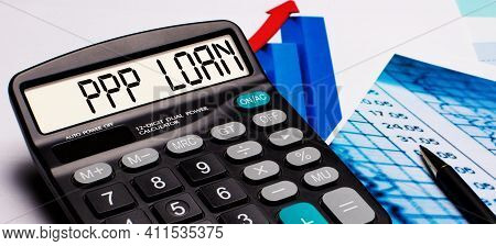 On The Calculator Display There Is An Inscription Ppp Loan. Nearby Are Colored Diagrams And Graphs.