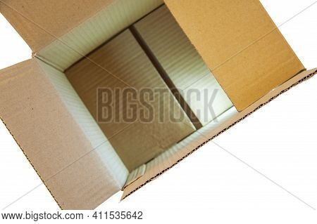 Open Cardboard Box Made Of Corrugated Cardboard For Packing Different Things On A White Background.