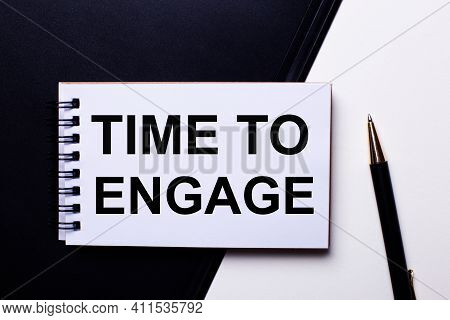 The Words Time To Engage Written In Red On A Black And White Background Near The Pen