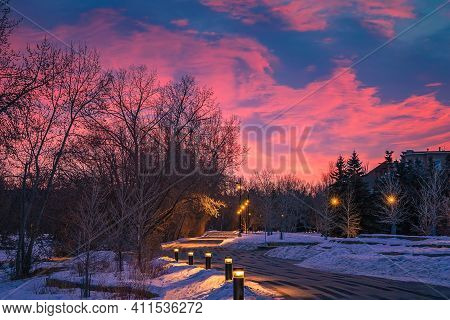 Bright Sunrise Clouds Over A Wintry Pathway