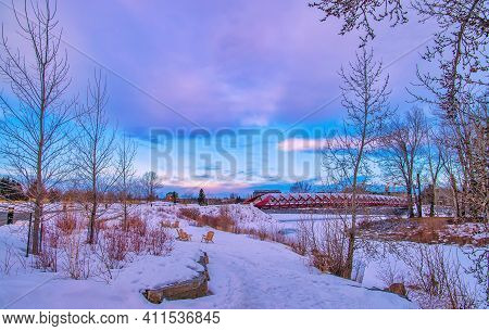 Colourful Sunrise Sky Over A Wintry Peace Bridge And River Valley