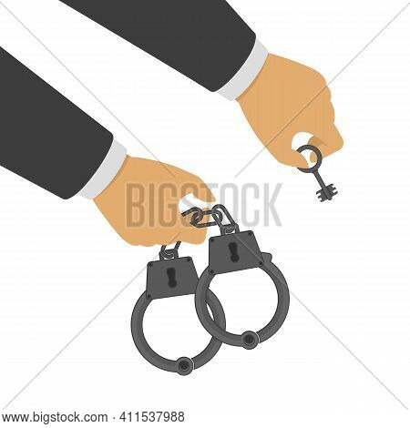 Hand Holding A Handcuffs And Key. A Crime, Corruption And Arrest Concept. Handcuffs In The Hands Of