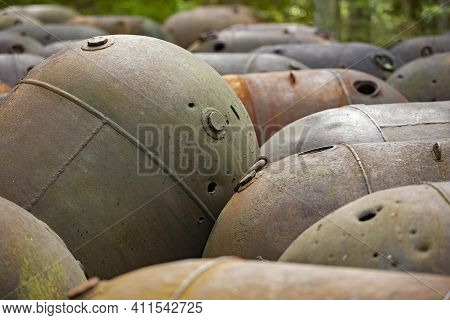 Old Naval Mines Piled Together In The Forest On The Island Of Naissaar, Estonia, Europe