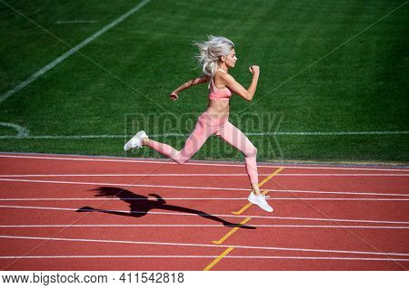 Athletic Lady Compete In Sprint. Sport Healthy Lifestyle. Fitness Training Outdoor. Runner Run Fast