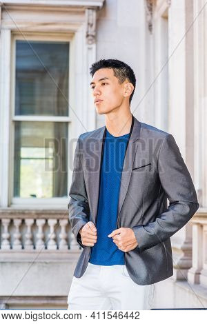 Portrait Of Young Asian American College Student In New York, Wearing Gray Blazer, Blue Undershirt,