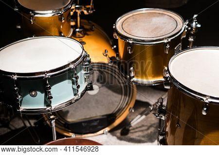 Closeup Professional Musical Instrument. Drum Kit For Jazz Band In Recording Studio. Drumsticks Lyin