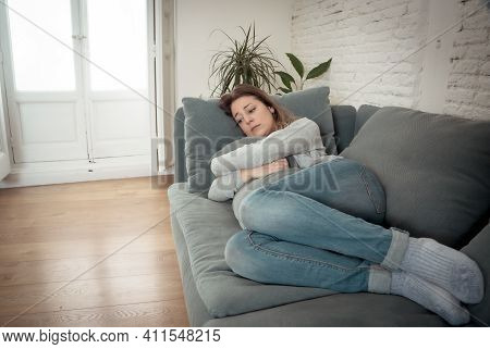 Young Sad Woman Suffering From Depression Feeling Desperate And Lonely At Home