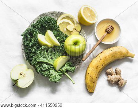 Smoothie Detox Drink Ingredients - Kale, Apple, Banana, Honey, Ginger, Lemon On A Light Background,