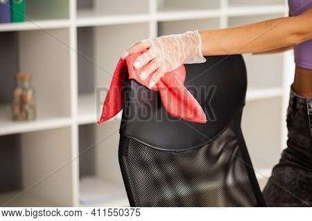 Employee Of A Cleaning Company Cleans The Office