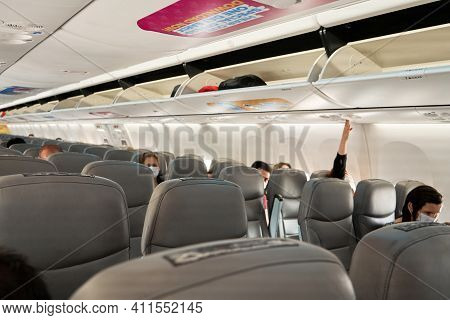 Half Empty Cabin Of A Passenger Plane. Empty Seats For Passengers. Airplane Interior
