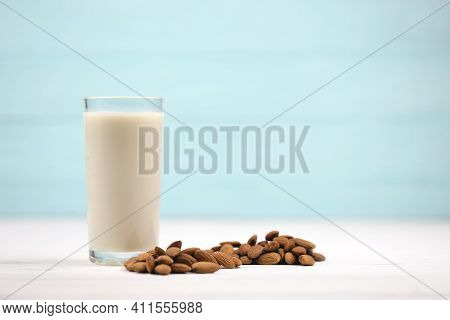 Glass Of Almond Milk With Almond Nuts On White Wooden Table. Dairy Alternative Milk For Detox, Healt