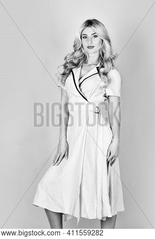 Clothes Shop. Beauty And Fashion. Curly Blonde In Blue Dress. Girl Wearing Vintage Outfit Long Simpl