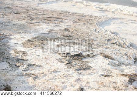 Pamukkale Travertines Texture Background. Surface Of Pamukkale Travertines Terraces. Unesco World He