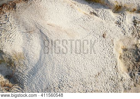Pamukkale Travertine Texture. Wavy Limestone Textured Deposits On Terraces Of Carbonate Minerals In