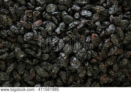 Dried Black Plums Background. Pile Of Dried Pruns Close Up. Healthy Organic Food.
