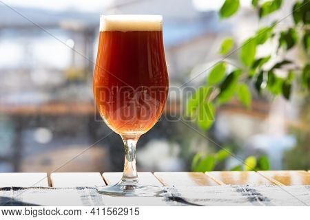 A Delicious Glass Of Home Brewed Craft Beer On A Table