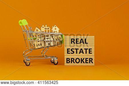 Real Estate Broker Symbol. Wooden Blocks With Words 'real Estate Broker' On Beautiful Orange Backgro