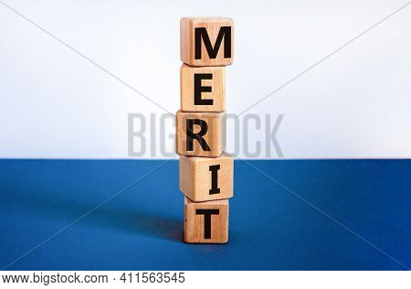 Merit Symbol. Wooden Cubes With The Word 'merit'. Beautiful White And Blue Background, Copy Space. B