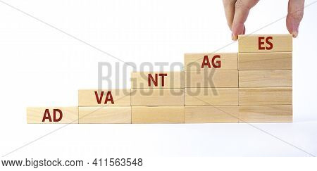 Advantages Symbol. Wooden Blocks Stacking As Step Stair On White Background, Copy Space. Businessman