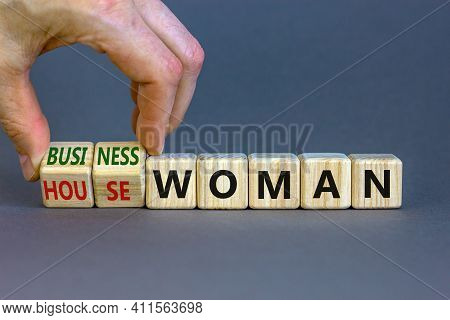 Housewoman Or Businesswoman Symbol. Businessman Turns Cubes And Changes The Word Housewoman To Busin