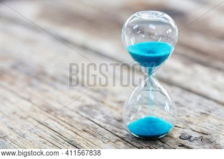 Blue hourglass business background concept for deadline, urgency and countdown