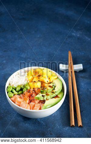 Salmon Poke Bowl Raw Fish Salad Asian Trendy Food, Mango, Soy Beans Edamame, Rice, Avocado, Served I