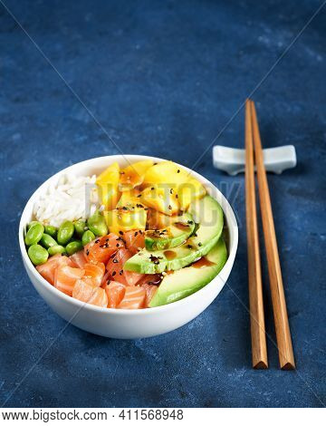 Healthy And Clean Eating Concept. Salmon Poke Bowl Raw Fish Salad, Mango, Soy Beans Edamame, Rice, A