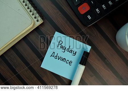 Payday Advance Write On Sticky Notes Isolated On Wooden Table.