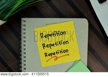Repetition, Repetition, Repetition Write On Sticky Notes Isolated On Wooden Table.