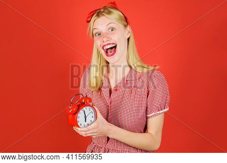 Time. Smiling Woman With Alarm Clock. Beautiful Girl With Retro Alarm-clock. Saving Time Concept. Bl