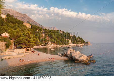 Makarska, Croatia - September 6, 2019: Beautiful beach at Adriatic Sea in Makarska Riviera, Dalmatia, Croatia