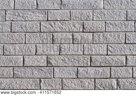 Beautiful Grey Stone Wall Background Texture With Different Shapes, Illuminated By The Sun