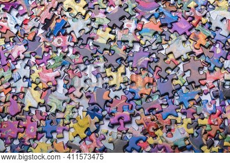 A Lot Of Scrambled Puzzle Pieces. Abstract Background Of Scattered Puzzle Pieces. Textured Backgroun