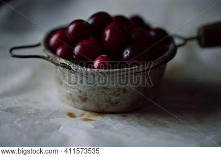 Fresh Cranberries In Vintage Tea Strainer. Selective Focus On Cranberries. Close Up.