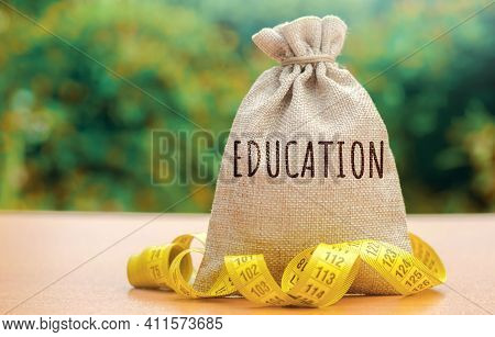 Money Bag With The Word Education. The Concept Of Saving Money For Studies. Investments Of Budgetary
