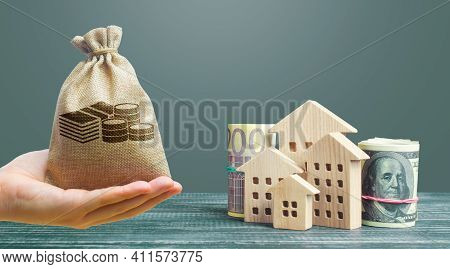 Money Bag, Residential Buildings And Dollar Euro Money. House Maintaining Cost, Utility Bills. Prope