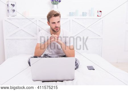 Online Work From Home Computer. Unshaven Man Use Laptop In Bed. Computer Technology. Working From Ho